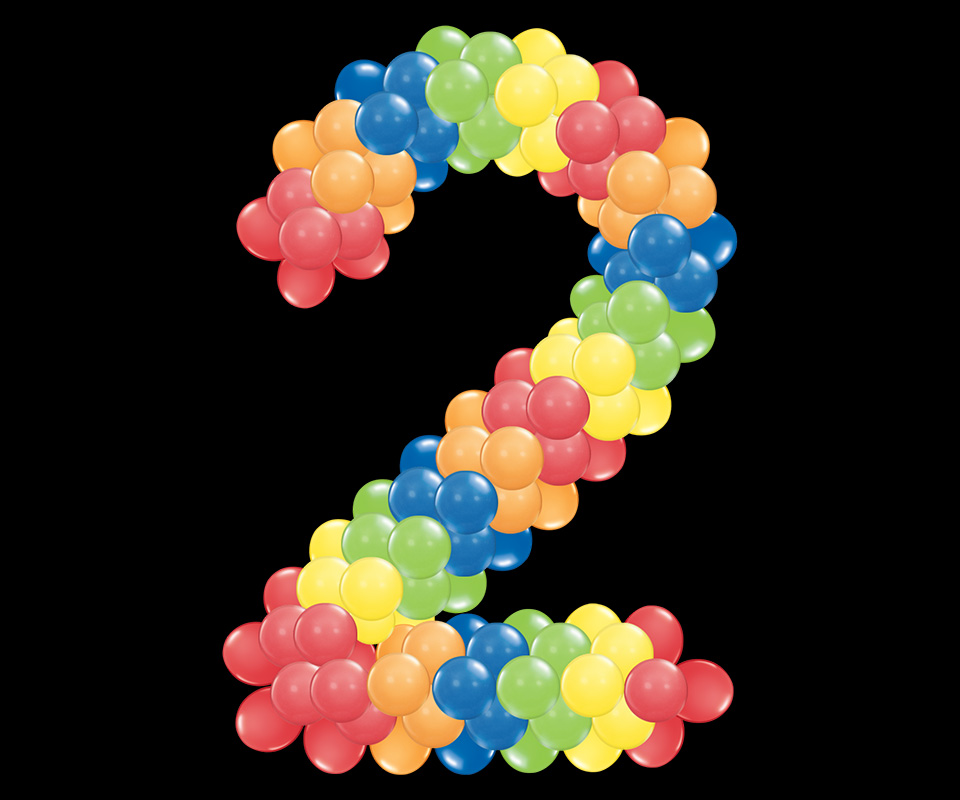 number 2 with round balloons in rainbow colors