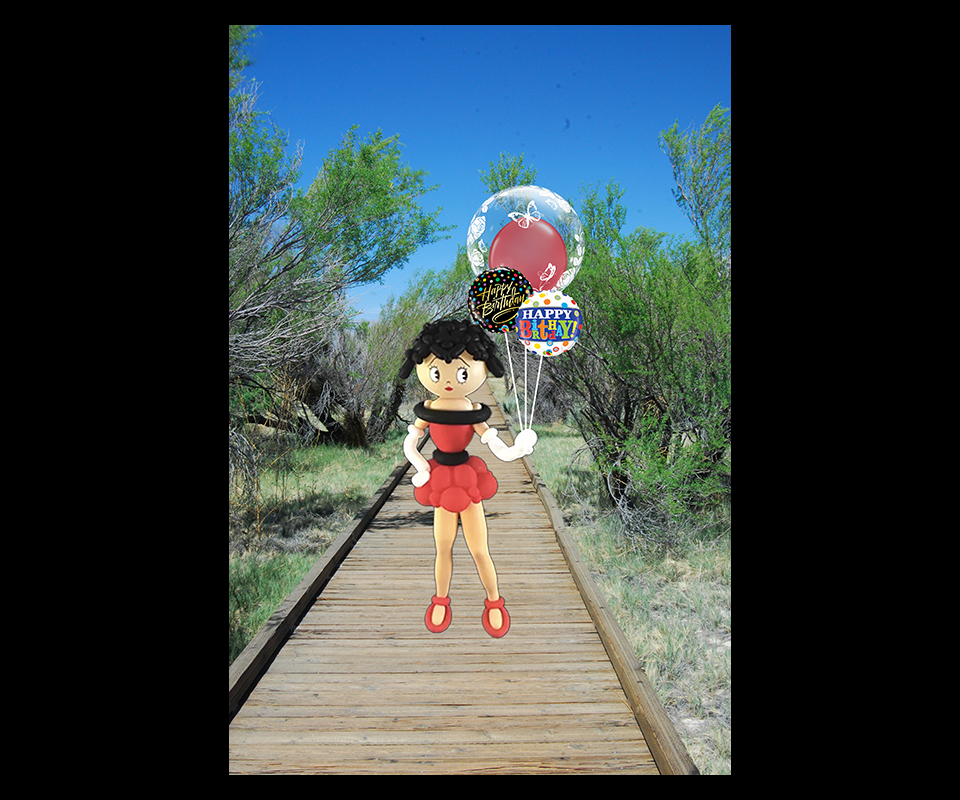 Betty Boop made out of latex balloons holding a small helium balloon bouquet in a park